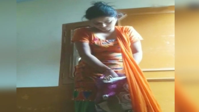 woman-stuffing-girl-in-a-bag-mercilessly